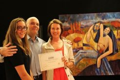 "Artist Olga Bakhtina with family in front of the winning work ""Good Samaritan"""
