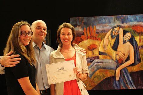"Artist Olga Bakhtina with family in front of the winning work ""Good Samaritan"""