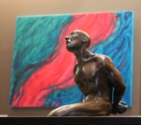 """In the foreground """"The Captive"""" by Kris-Ann Ehrich and in the background """"The River of Love"""" by Michelle Bowden"""