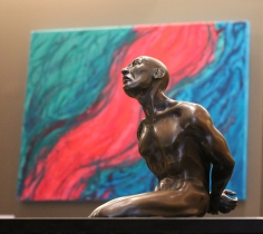"In the foreground ""The Captive"" by Kris-Ann Ehrich and in the background ""The River of Love"" by Michelle Bowden"